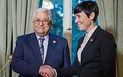 Norwegian Foreign Ministers Ine Eriksen Soreide welcomes Palestinian Authority President Mahmoud Abbas for a dinner in Oslo, Norway, on Septmeber 18, 2019. (Heiko Junge/NTB Scanpix/AFP)