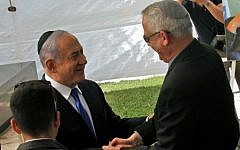 Prime Minister Benjamin Netanyahu (L) greets Benny Gantz, leader of Blue and White party, at a memorial ceremony for late Israeli president Shimon Peres, at Mount Herzl in Jerusalem on September 19, 2019. (GIL COHEN-MAGEN/AFP