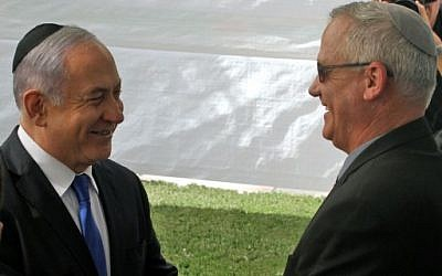 Prime Minister Benjamin Netanyahu (L) greets Benny Gantz, leader of Blue and White party, at a memorial ceremony for late Israeli president Shimon Peres, at Mount Herzl in Jerusalem on September 19, 2019. (GIL COHEN-MAGEN/AFP)