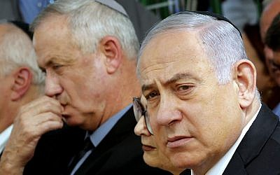 Supreme Court Esther Hayut (C) is flanked by Prime Minister Benjamin Netanyahu (R), and Benny Gantz (L), leader of Blue and White party, at a memorial ceremony for late president Shimon Peres, at Mount Herzl in Jerusalem on September 19, 2019. (GIL COHEN-MAGEN / AFP)