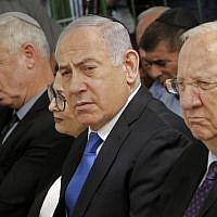 President Reuven Rivlin, right, Prime Minister Benjamin Netanyahu, center, and Blue and White leader Benny Gantz, left, at a memorial ceremony for the late president Shimon Peres, at Mount Herzl in Jerusalem on September 19, 2019. (Gil Cohen-Magen/AFP)
