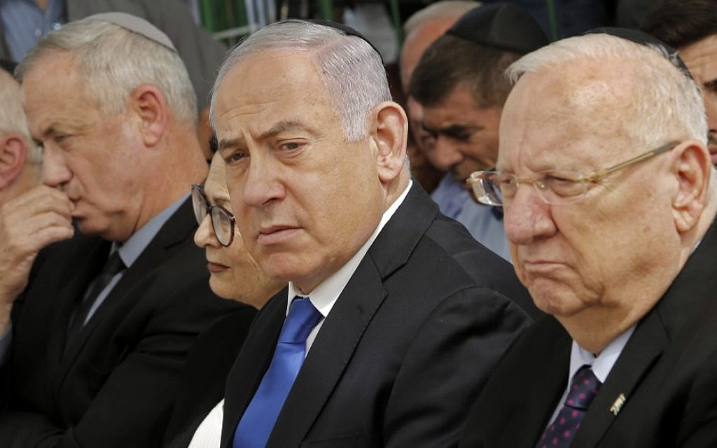 President Reuven Rivlin, right, Prime Minister Benjamin Netanyahu, center, and Blue and White leader Benny Gantz, left, at a memorial ceremony for the late president Shimon Peres, at Mount Herzl in Jerusalem, on September 19, 2019. (Gil Cohen-Magen/AFP)