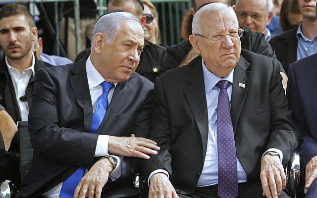 Prime Minister Benjamin Netanyahu (L) and President Reuven Rivlin attend a memorial ceremony for late president Shimon Peres, at Mount Herzl cemetery in Jerusalem on September 19, 2019. (GIl Cohen-Magen/AFP)