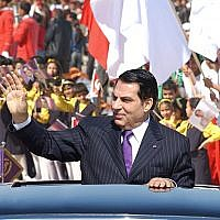 In this photo taken on March 20, 2006 former Tunisian president Zine El Abidine Ben Ali waves to the crowd upon arrival in Rades stadium where he delivered his speech on the 50th anniversary of independence of Tunisia from France. - (Handout / AFP)