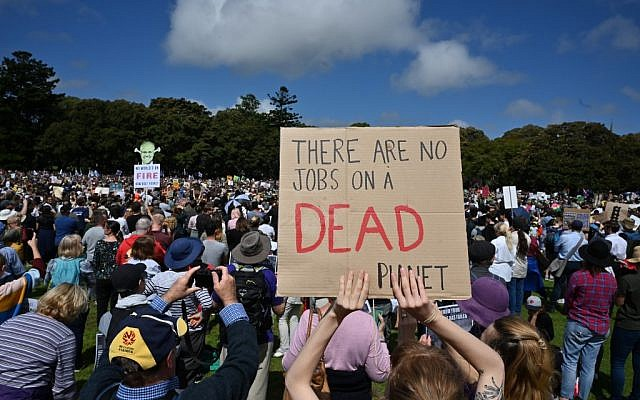 People attend a protest as part of the world's largest climate strike in Sydney on September 20, 2019. (PETER PARKS / AFP)