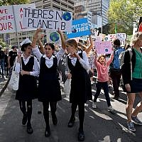School children attend a protest march as part of the world's largest climate strike in Sydney on September 20, 2019.  (PETER PARKS / AFP)