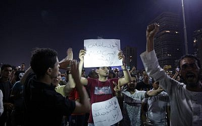 Egyptian protesters shout slogans as they take part in a protest calling for the removal of Egypt's President Abdel Fattah el-Sissi in Cairo's downtown on September 20, 2019. (Stringer/AFP)