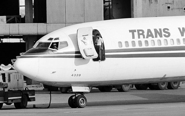 In this photo from June 19, 1985, two hijackers of TWA Flight 847 emerge from the plane at Beirut airport. (Nabil Ismail/AFP)