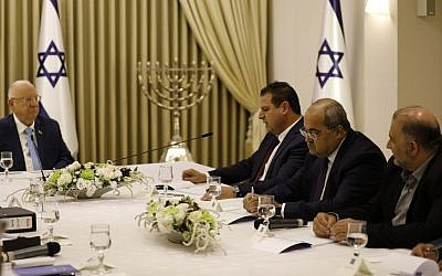 President Reuven Rivlin meets with Joint List members Ayman Odeh (3rd-R), Ahmad Tibi (2nd-R) and Mansour Abbas (R) during consultations on who should be tasked with forming the next government, at the President's Residence in Jerusalem on September 22, 2019. (Menahem Kahana/AFP)