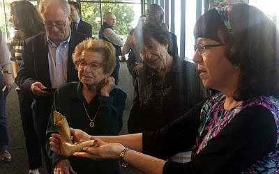 Judith Tydor Baumel-Schwartz, daughter of Chaskel Tydor who survived the Auschwitz death camp, presents a shofar used inside Auschwitz during a press conference at the Museum of Jewish Heritage on September 23, 2019 in New York. (Thomas URBAIN / AFP)