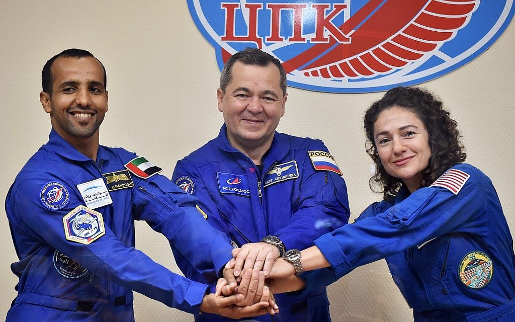 Members of the main crew to the International Space Station (ISS), United Arab Emirates' astronaut Hazza Al Mansouri (left), Russian cosmonaut Oleg Skripochka and US astronaut Jessica Meir pose during a press conference at the Russian-leased Baikonur cosmodrome in Kazakhstan on September 24, 2019. (Vyacheslav OSELEDKO / AFP)