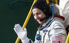 International Space Station (ISS) crew member, NASA's US astronaut Jessica Meir waves as she boards the Soyuz MS-15 spacecraft before its blasts off for the ISS, on September 25, 2019 at the Russian-leased Baikonur cosmodrome in Kazakhstan. (Maxim Shipenkov/Pool/AFP)