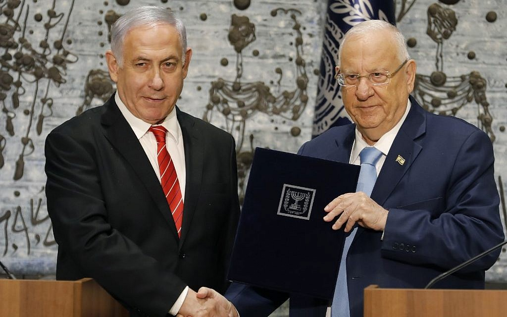 President Reuven Rivlin, right  tasks Prime Minister Benjamin Netanyahu with forming a new government, during a press conference at the President's Residence, in Jerusalem on September 25, 2019. (Menahem Kahana/AFP)