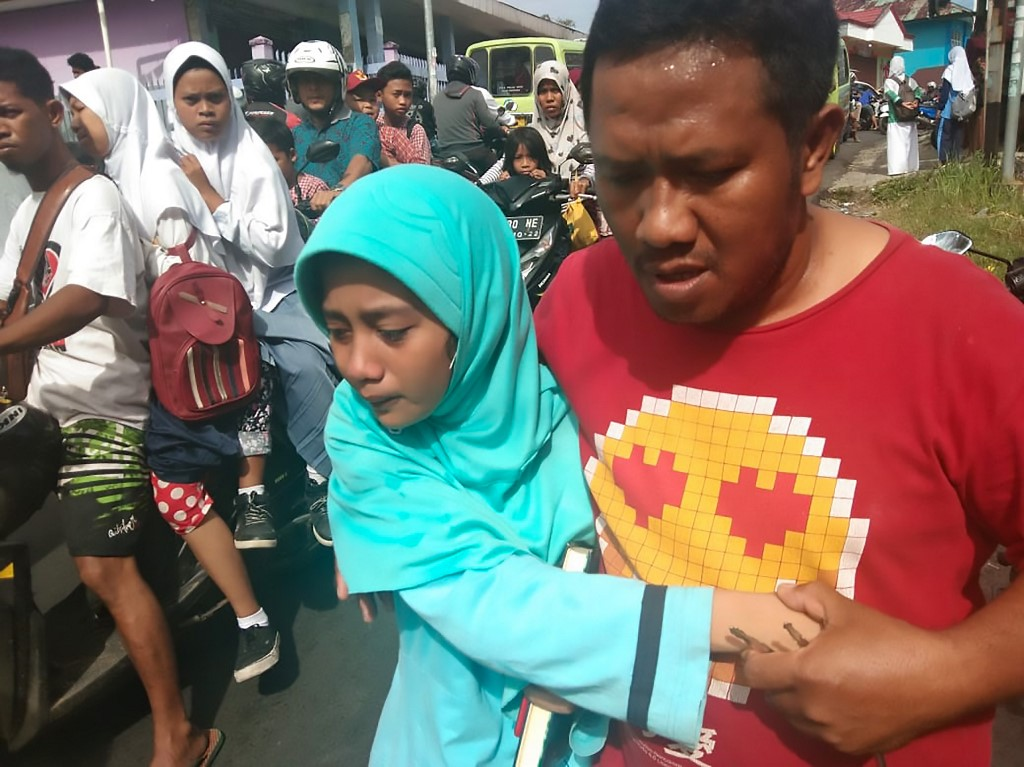 People scatter in panic as natural disaster hits Ambon, Indonesia