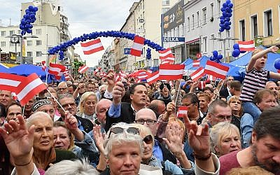 Supporters wave Austrian flags as they attend an election rally of the Austrian Freedom Party (FPOe) in Vienna, Austria on September 27, 2019. (JOE KLAMAR/AFP)