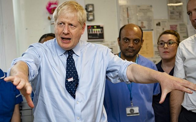 Britain's Prime Minister Boris Johnson gestures during a visit to North Manchester General Hospital in north-west England on September 29, 2019, ahead of the opening day of the annual Conservative Party conference. (Andy Stenning / POOL / AFP)
