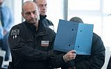 "One of the defendants of the so-called ""Revolution Chemnitz"" is brought to the courtroom in Dresden, eastern Germany, on September 30, 2019, on the first day of the trial of an alleged neo-Nazi terrorist cell accused of plotting violent political upheaval in Germany. (Sebastian Kahnert/Pool/AFP)"