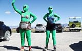 Women are dressed as aliens at a 'Storm Area 51' spinoff event called 'Alienstock' on September 20, 2019 in Rachel, Nevada. (Mario Tama/Getty Images/AFP)