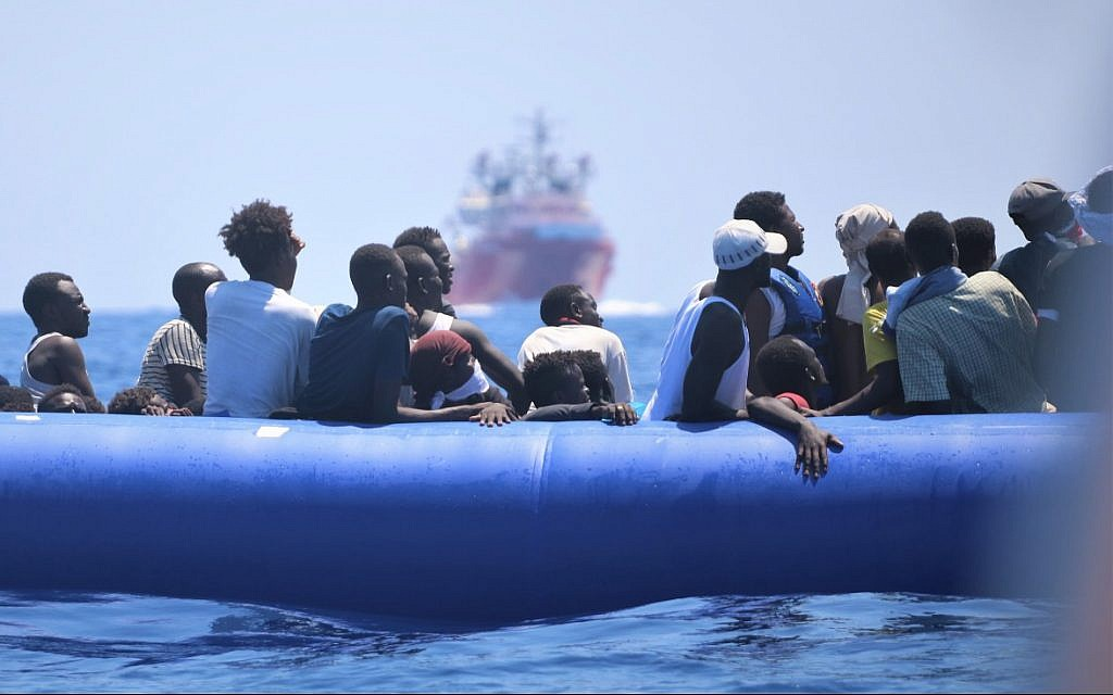Refugees aboard a blue rubber dinghy soon to be picked up by the Ocean Viking, August 2019. (Hannah Wallace Bowman/SOS Mediterranee)