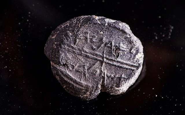 A small 7th century BCE clay sealing reading 'Belonging to Adoniyahu, Royal Steward,' recently discovered in the City of David's sifting project, taken from earth excavated under Robinson's Arch. (Eliyahu Yanai/Courtesy City of David)