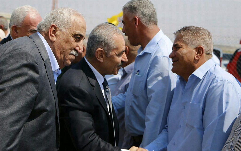 Palestinian Authority Prime Minister Mohammad Shtayyeh greeting residents of Fasayil, a Palestinian village in the Jordan Valley, on September 16, 2019. (Wafa)