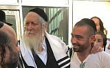 Eliezer Berland (L) with Israeli pop star Omer Adam (via Facebook)