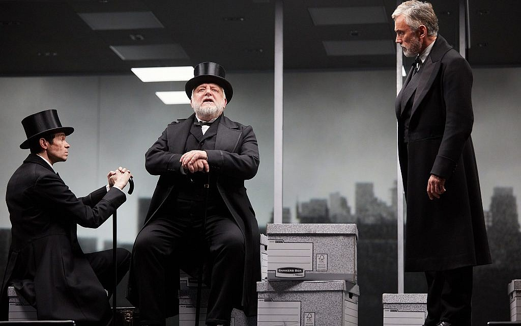 British-Jewish actor Adam Godley, left, along with Simon Russell Beale, center, and Ben Miles, in 'The Lehman Trilogy,' at the National Theatre. (Mark Douet)
