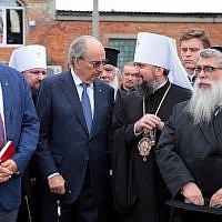 Yaakov Dov Bleich, right, chief rabbi of Ukraine, with Canada's ambassador to Ukraine, Roman Waschuk, left, and primate of the Orthodox Church of Ukraine, His Beatitude Epifanii, second from right, Aug. 21, 2019 (Aliona Nikolaievych/Barcroft Media via Getty Images via JTA)
