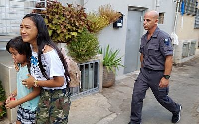 Mika and Maureen Velasco being arrested in August. (United Children of Israel, courtesy)