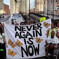 Jewish Never Again Action activists march across the Longfellow Bridge between Boston and Cambridge, Massachusetts, toward Amazon's Cambridge office after rallying at the New England Holocaust Memorial, September. 5, 2019. (Barry Chin/The Boston Globe via Getty Images via JTA)