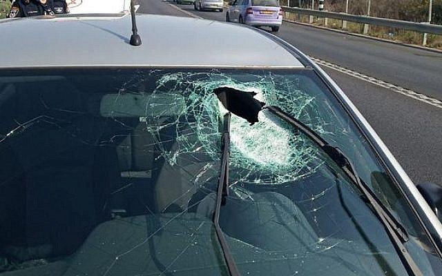 The windshield of a car whose driver was hit by a rock and moderately injured in the West Bank, Friday, September 20, 2019 (Rescue services)