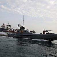 In this July 21, 2019 file photo, a speedboat of Iran's Revolutionary Guard moves around a British-flagged oil tanker, the Stena Impero, which was seized by the Guard, in the Iranian port of Bandar Abbas. (Hasan Shirvani/Mizan News Agency via AP, File)