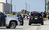 Odessa and Midland police and sheriff's deputies surround the area behind Cinergy movie theater in Odessa, Texas, August 31, 2019, after reports of gunfire (Tim Fischer/Midland Reporter-Telegram via AP)
