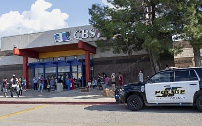 Odessa police officers park their vehicle outside Music City Mall in Odessa, Texas, on August 31, 2019, as they investigate areas following a deadly shooting in the area of Odessa and Midland. (Jacy Lewis/Reporter-Telegram via AP)