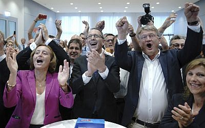 Chairman of right-wing party Alternative for Germany, AfD, Joerg Meuthen, second from right, top candidate Joerg Urban, center, top candidate for the Saxony state elections and board member Beatrix von Storch, left, react after first election results announced in Dresden, Germany, September 1, 2019. (Michael Kappeler/dpa via AP)