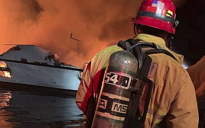 In this photo provided by the Ventura County Fire Department, VCFD firefighters respond to a boat fire off the coast of southern California, September 2, 2019. (Ventura County Fire Department via AP)