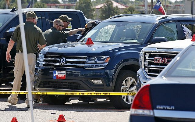 Officials continue to work the scene, September 2, 2019, in Odessa, Texas, where teenager Leilah Hernandez was fatally shot at a car dealership during a shooting rampage. (AP Photo/Sue Ogrocki)