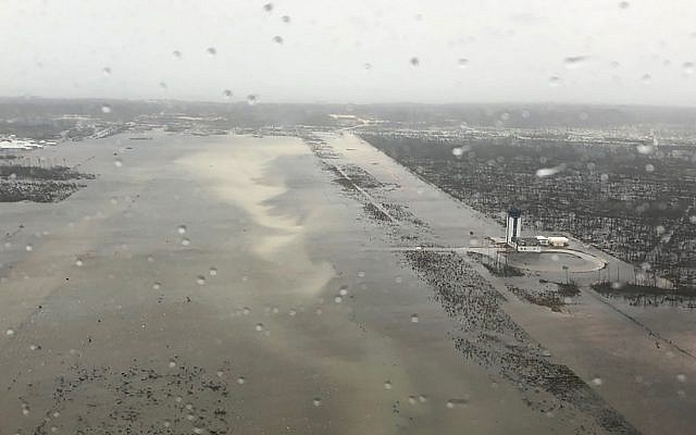 This September 2, 2019 photo released by the US Coast Guard Station Clearwater, shows flooding on the runway of the Marsh Harbour Airport in the Bahamas. (US Coast Guard Station Clearwater via AP)