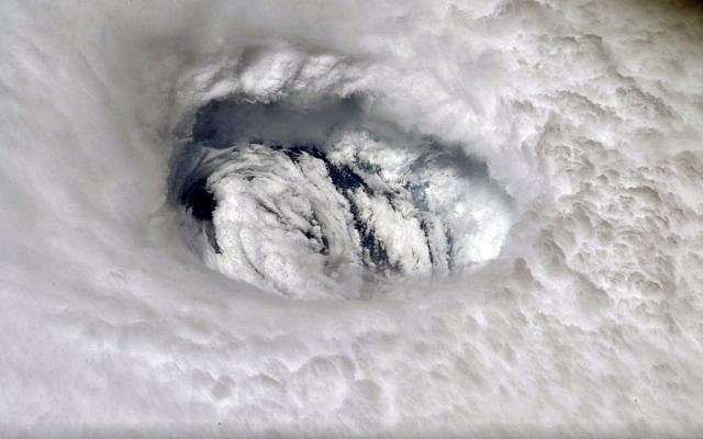 This September 2, 2019 photo provided by NASA shows the eye of Hurricane Dorian shown from the International Space Station. (Nick Hague/NASA via AP)