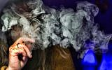 A woman takes a puff from a cannabis vape pen in Los Angeles, December 22, 2018. (AP Photo/Richard Vogel)