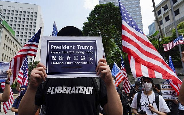 Protesters waves United States flags and placards during a protest in Hong Kong,  September 8, 2019. (Vincent Yu/AP)