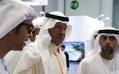 Saudi Arabia's new Energy Minister Prince Abdulaziz bin Salman, center, and United Arab Emirates Energy Minister Suhail al-Mazrouei, right, walk through an energy exhibition in Abu Dhabi, United Arab Emirates, September 9, 2019. (Jon Gambrell/AP)