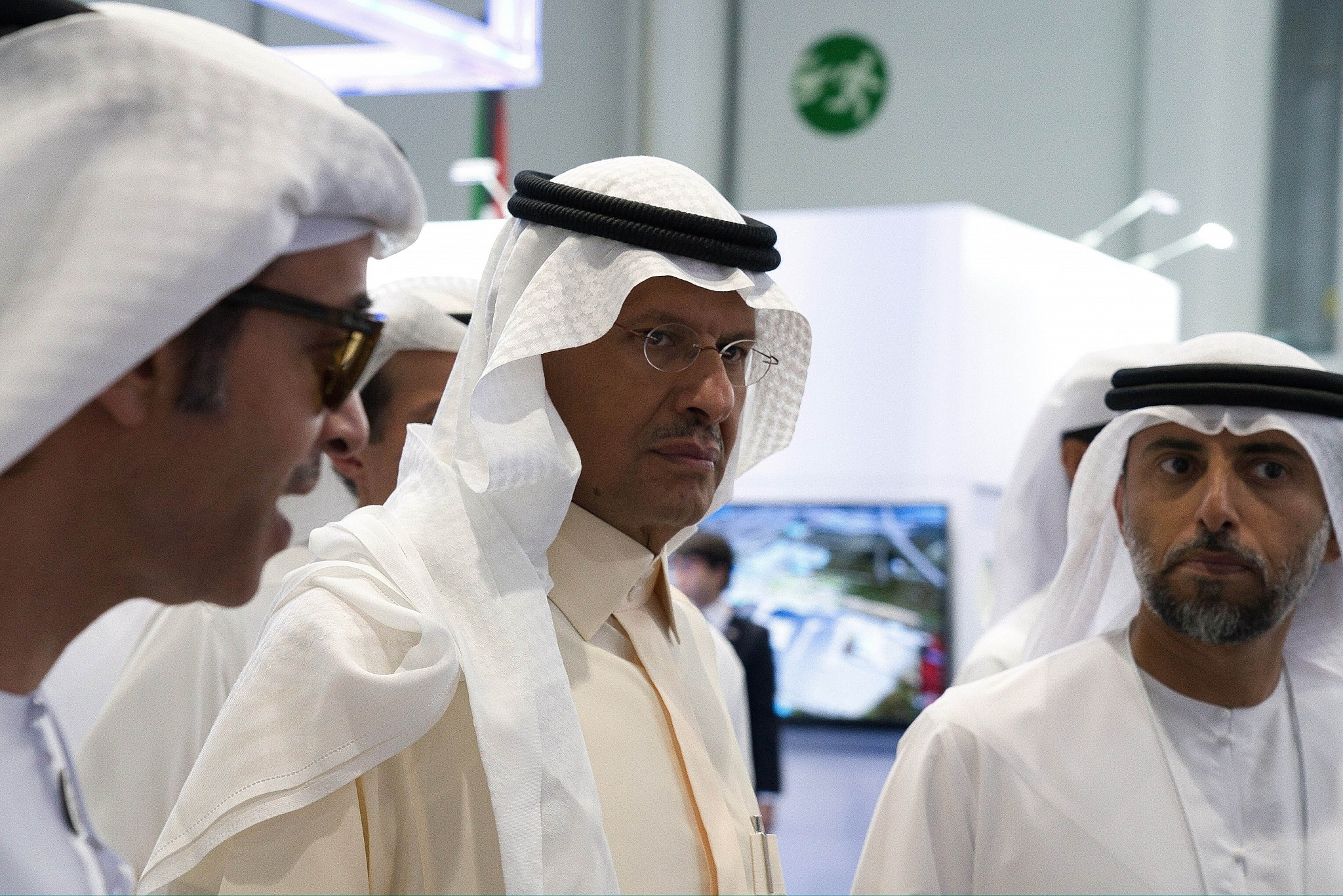 Saudi Arabia's new Energy Minister Prince Abdulaziz bin Salman center and United Arab Emirates Energy Minister Suhail al-Mazrouei right walk through an energy exhibition in Abu Dhabi United Arab Emirates Septembre 9 2019
