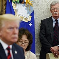 US President Donald Trump, left, meets with South Korean President Moon Jae-In in the Oval Office of the White House in Washington, as then-national security adviser John Bolton, right, watches, May 22, 2018. (Evan Vucci/AP)
