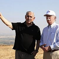 In this Sunday, June 23, 2019 file photo, US National Security Advisor John Bolton, right, and Israeli Prime Minister Benjamin Netanyahu, visit an old army outpost overlooking the Jordan Valley between the Israeli city of Beit Shean and the Palestinian city of Jericho. Netanyahu vowed Tuesday to annex the Jordan Valley if he wins national elections next week. (AP Photo/Abir Sultan, File)