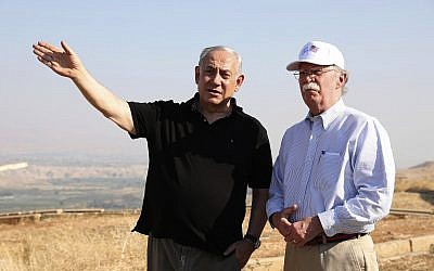 In this photo from, June 23, 2019 file photo, US National Security Advisor John Bolton, right, and Prime Minister Benjamin Netanyahu, visit an old army outpost overlooking the Jordan Valley between the Israeli city of Beit Shean and the Palestinian city of Jericho. Netanyahu vowed Tuesday to annex the Jordan Valley if he wins national elections next week. (AP Photo/Abir Sultan, File)