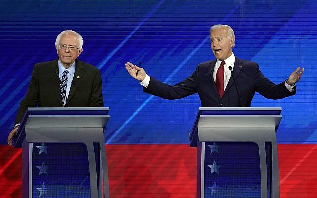 Sen. Bernie Sanders, I-Vt., left, listens as former Vice President Joe Biden, right, responds to a question Thursday, Sept. 12, 2019, during a Democratic presidential primary debate hosted by ABC at Texas Southern University in Houston. (AP Photo/David J. Phillip)