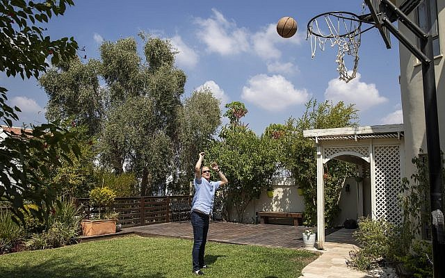 In this Friday, Sept. 13, 2019 photo, Blue and White party leader and former IDF chief of staff Benny Gantz throws the ball during a photoshoot at his garden in his home in Rosh Haayin, Israel. (AP Photo/Oded Balilty)