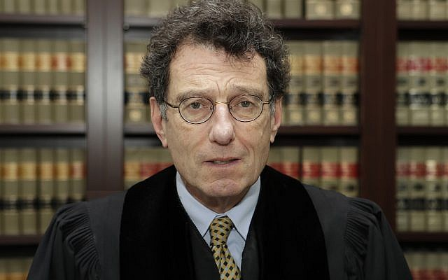This Jan. 11, 2018 file photo shows Judge Dan Polster in his office, in Cleveland. (AP/Tony Dejak)