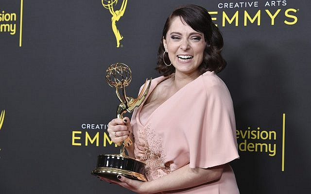 """Rachel Bloom poses in the press room with the award for outstanding original music and lyrics for """"Crazy Ex Girlfriend"""" on night one of the Creative Arts Emmy Awards on Saturday, Sept. 14, 2019, at the Microsoft Theater in Los Angeles. (Photo by Richard Shotwell/Invision/AP)"""